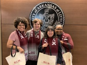 Members of the Office of the Chancellor receive tote bags after participating in the Campus Campaign.