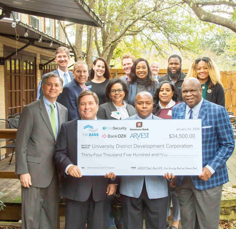 U.S. Congressman French Hill and representatives from Bank OZK, First Security Bank, Arvest Bank, Simmons Bank and the Federal Home Loan Bank of Dallas present funds to the University District Development Corporation and to World Services for the Blind, Jan 24, 2020. Photo by Business Wire.