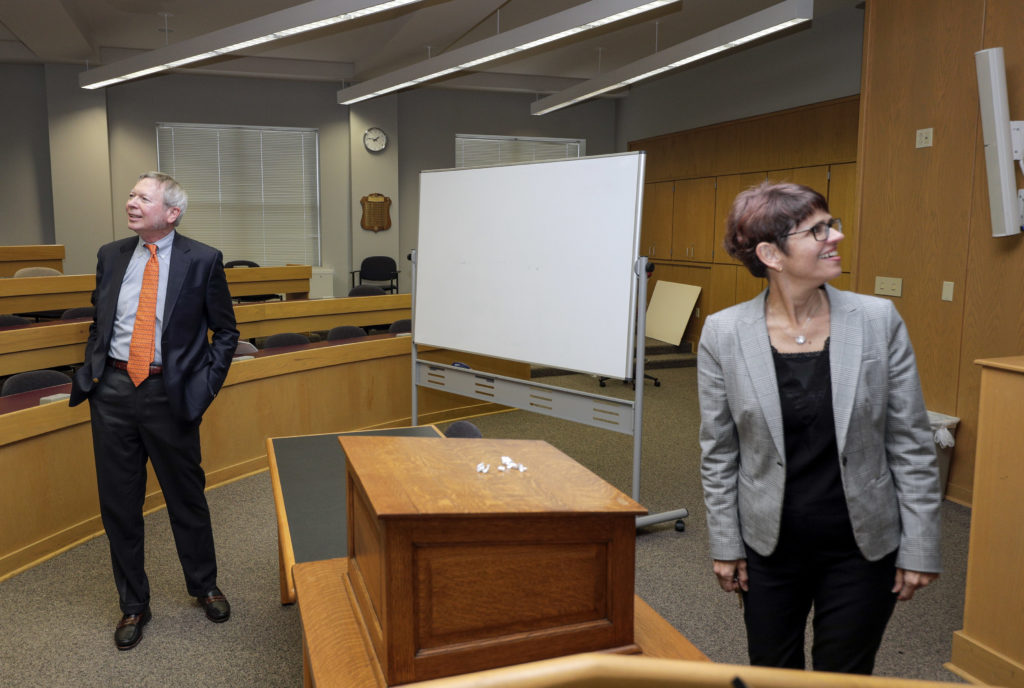 Bowen alum Wylie Cavin III (left) and Bowen Dean Theresa Beiner (right) tour the William H. Bowen School of Law. Photo by Ben Krain.