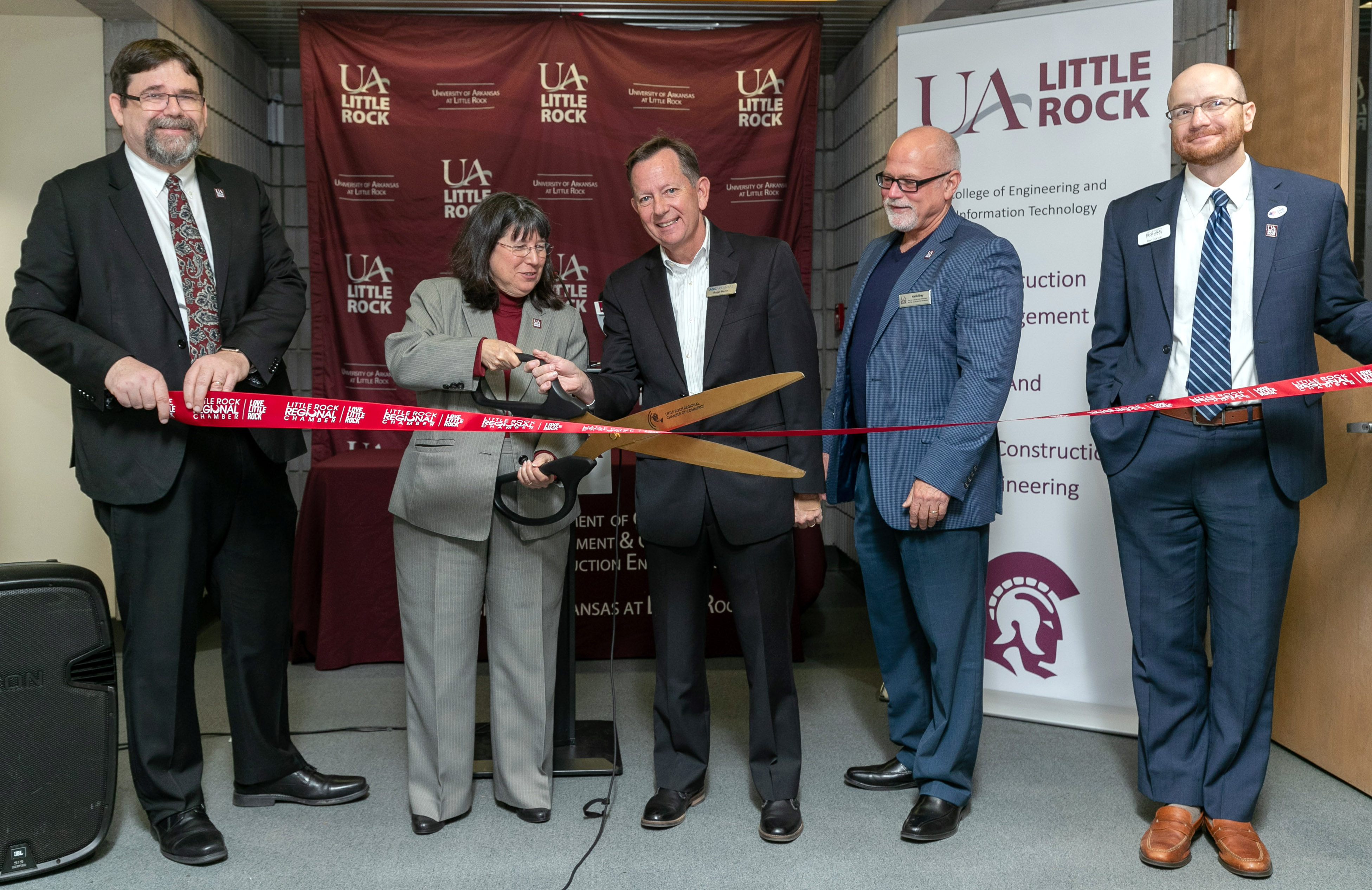 "UA Little Rock staff join donors and community leaders in a dedication ceremony for the university's new AGC of Arkansas Building Information Modeling Lab. Those pictured, L to R, include Dr. Lawrence Whitman, dean of the College of Engineering and Information Technology, Chancellor Christina Drale, Roger Marlin, immediate past president of AGC Arkansas, Dr. Hollis ""Hank"" Bray, chair of the Department of Construction Management and Civil and Construction Engineering, and Ben France, vice president of economic development at Little Rock Regional Chamber of Commerce. Photo by Ben Krain."