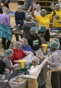 UA Little Rock students, faculty, and staff fill ready-to-cook meal bags during a Feed-the-Funnel philanthropy event facilitated by The Pack Shack hunger relief charity. Participants made 10,000 meals which will be donated to the Trojan Food Pantry. Photo by Ben Krain.