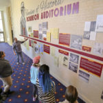 Photo of students visiting the historic timeline exhibit at Robinson Auditorium