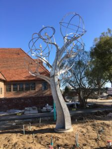 """Michael Warrick's latest sculpture, """"Mockingbird Tree with Oranges"""" was recently installed in Whittier, California."""