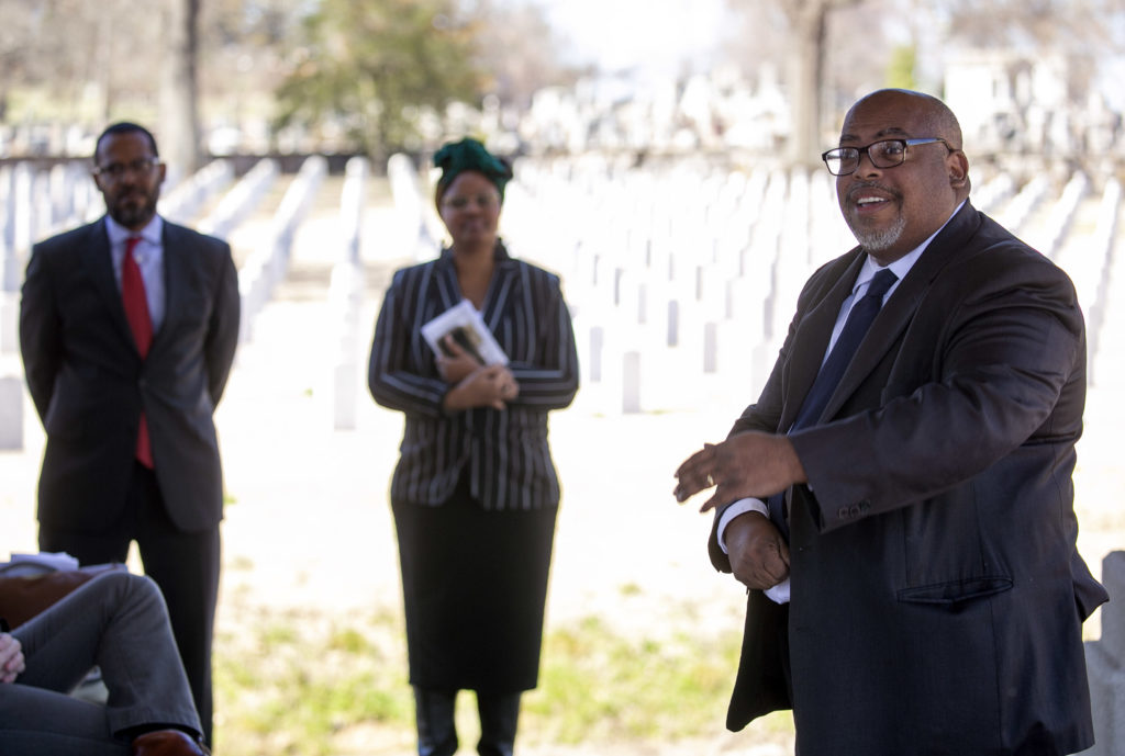 Brian Mitchell, middle, talks about the significance of an historic marker for Frank Moore, a member of the Elaine 12, placed March 6 in Little Rock National Cemetery. Photo by Ben Krain.