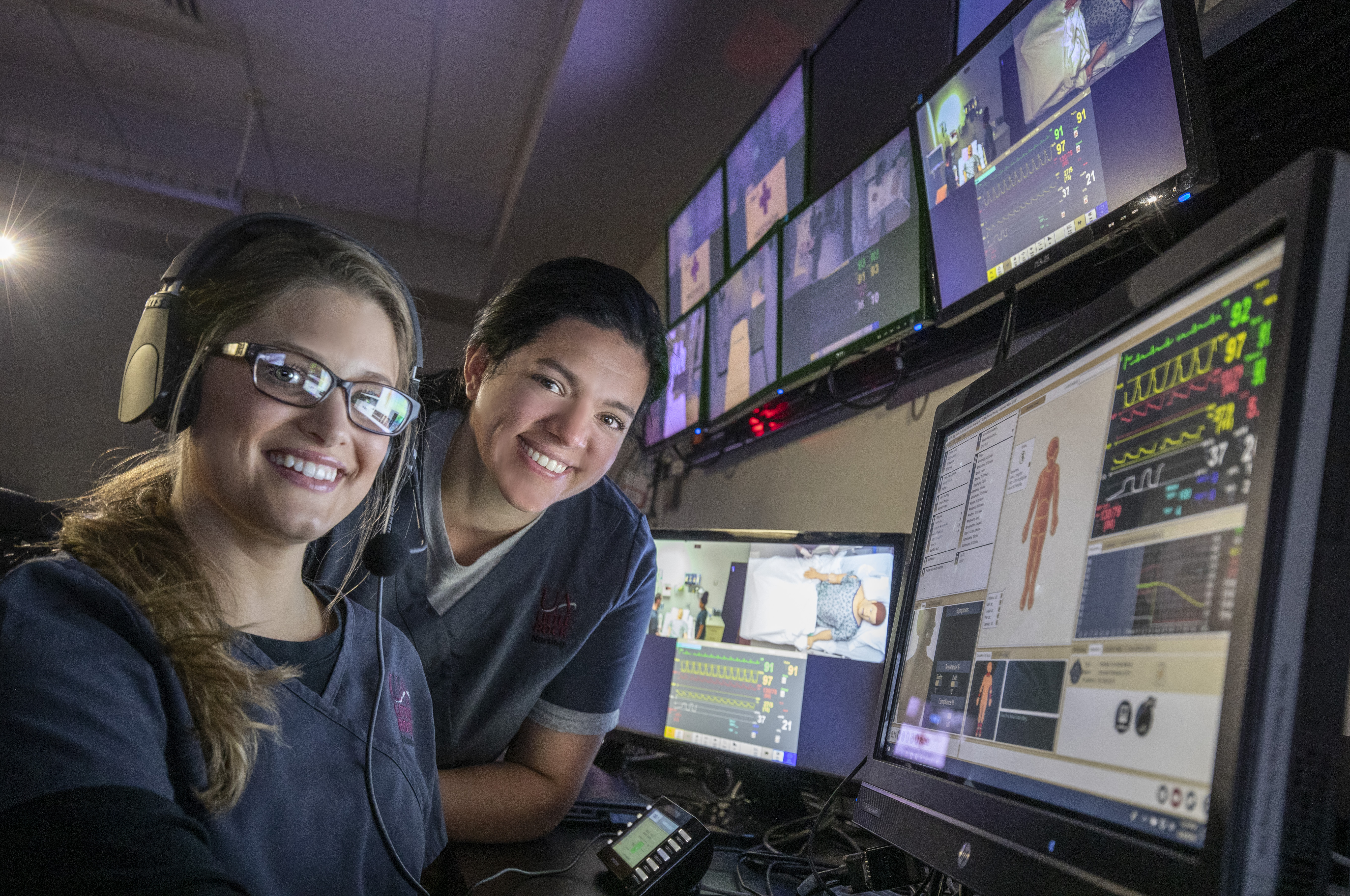 Nursing school students working with medical equipment in the SIM Lab, SIM Lab control room and Pixus units.