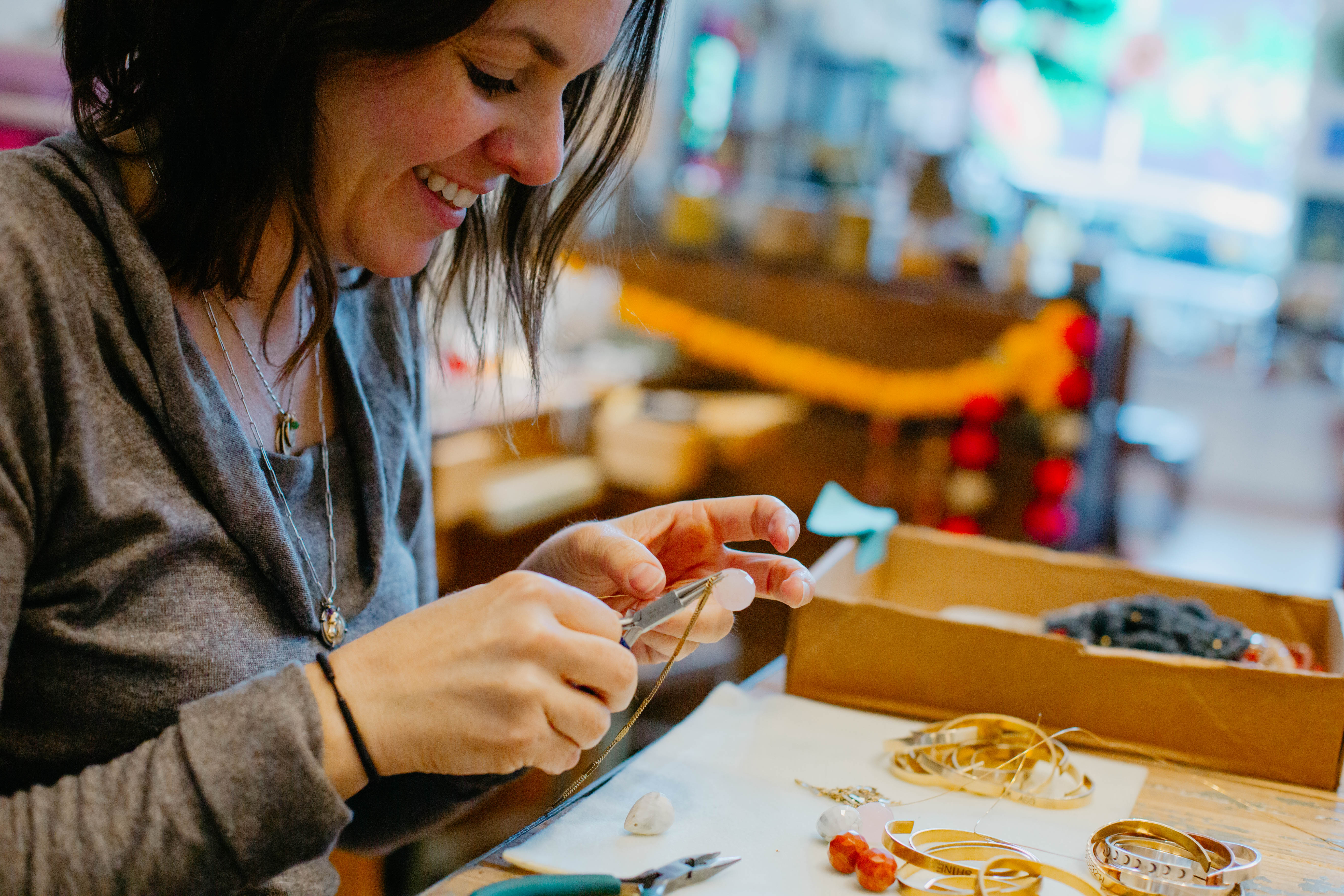 Bella Vita Jewelry owner Brandy McNair makes jewelry for her business.
