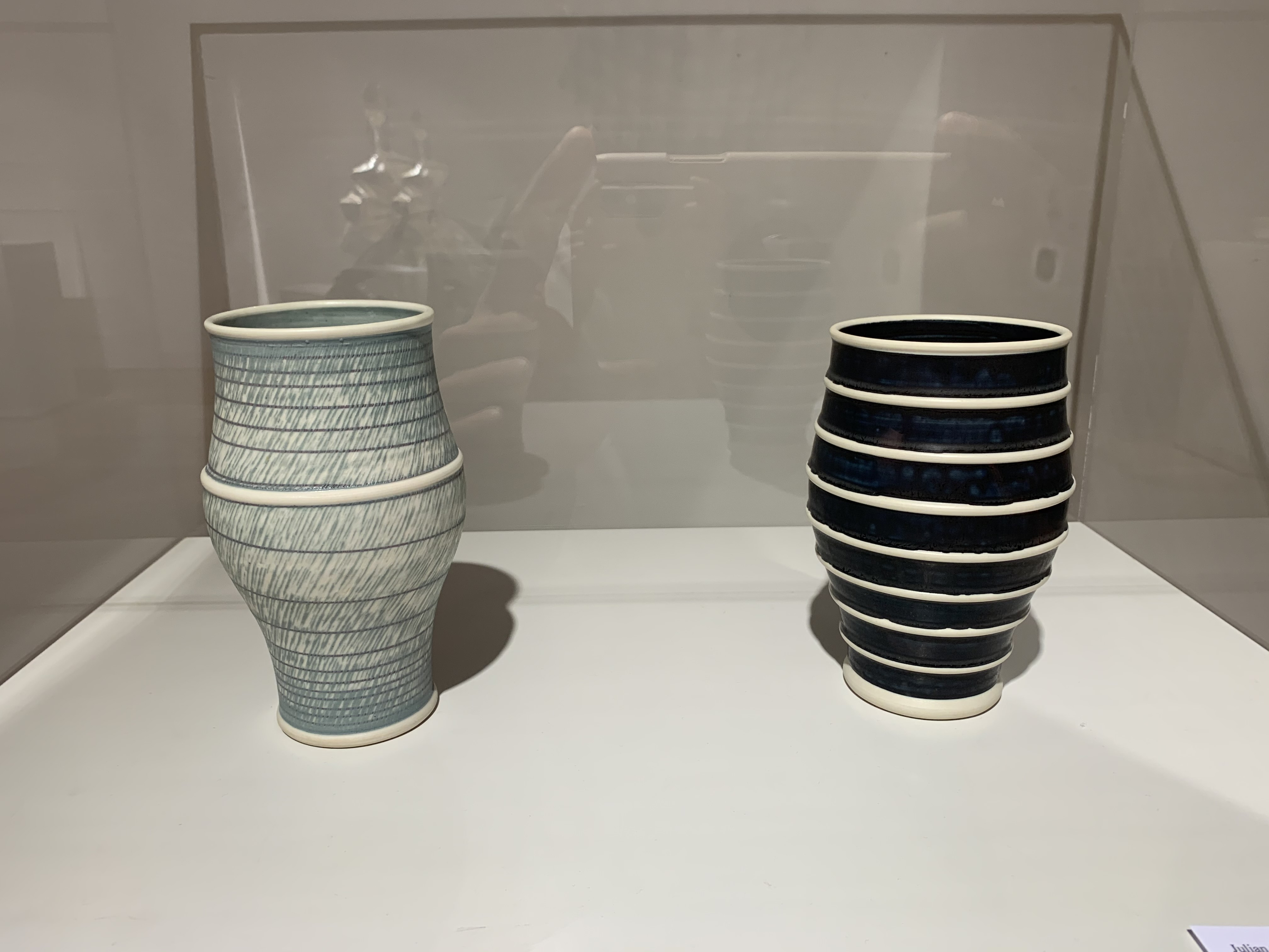 The two porcelain vessels were made by Julian Stair and are gifts of the Diane and Sandy Besser Collection.
