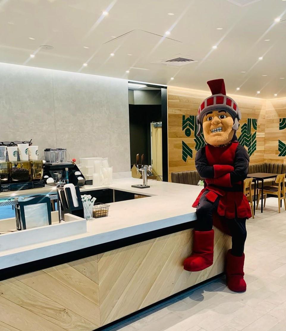 UA Little Rock's mascot checks out the new Starbucks.