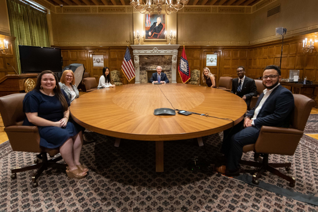 Joshua Johnson, second from right, is shown with Gov. Asa Hutchinson and his fellow summer interns.