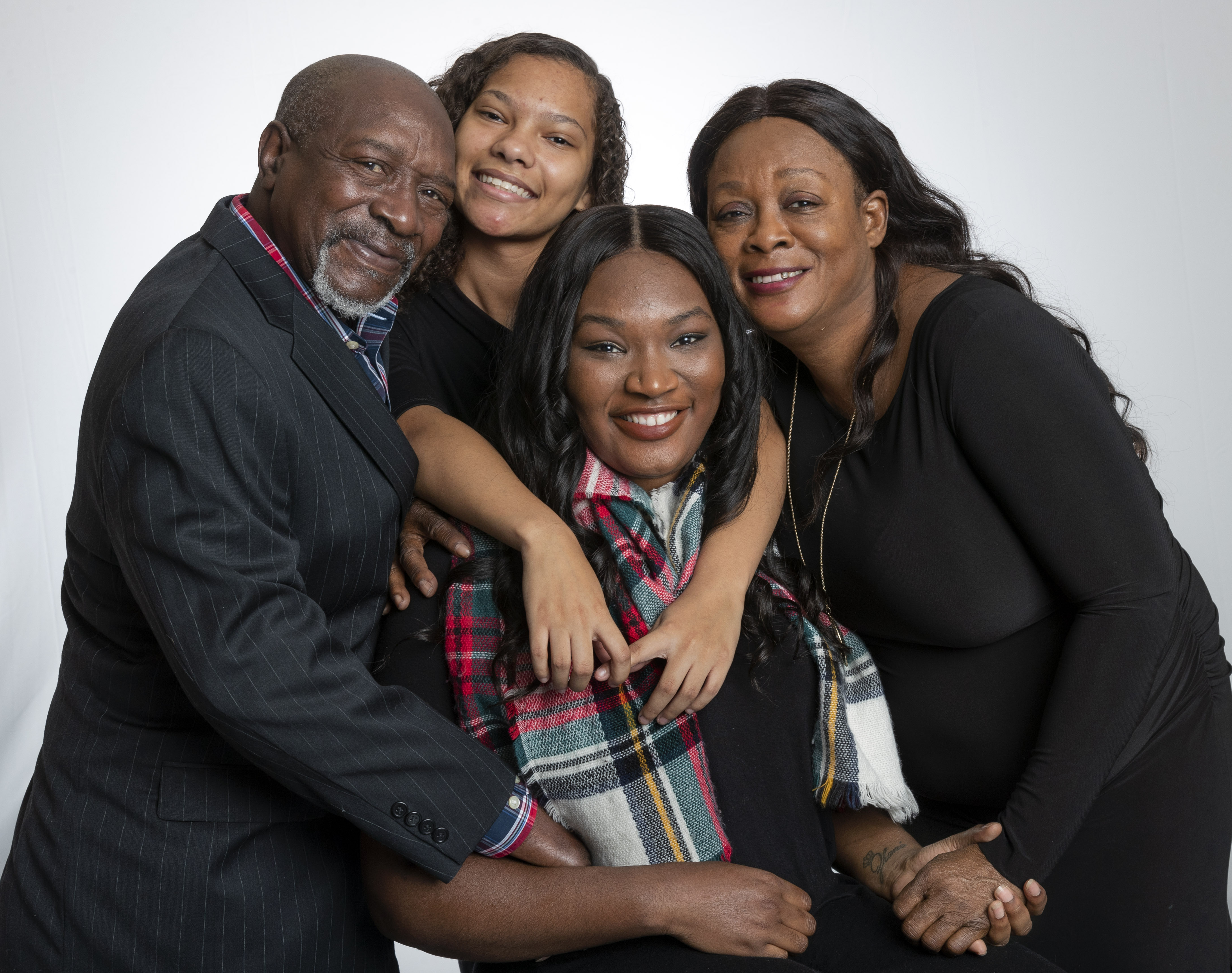 UA Little Rock student Social Work major Mercedes Parker, center, is surrounded by her family, from top left, Chester McCray, Taylor Houck and Ruby Dunn. Parker, who will graduate in December, is the first person in her family to get a college degree.