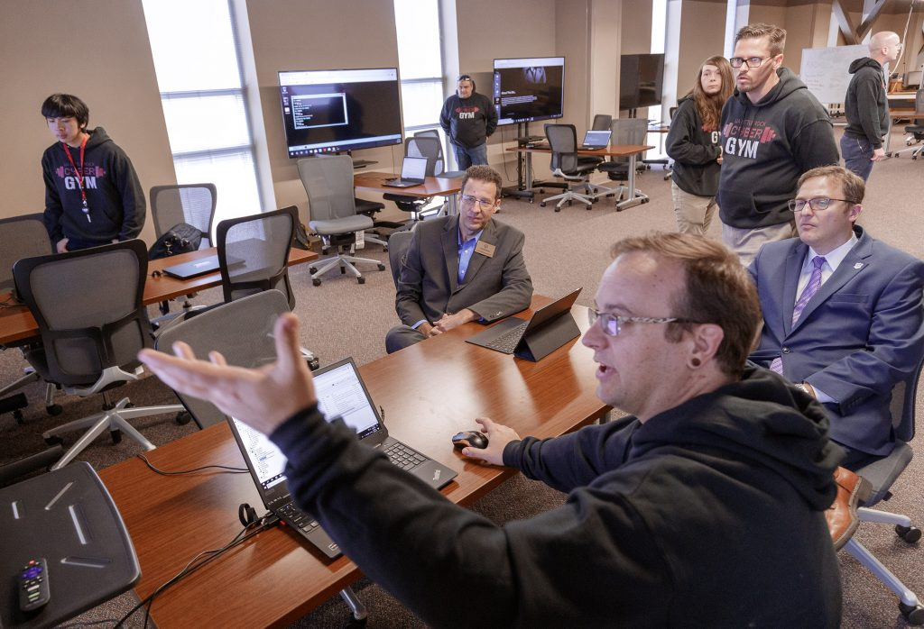 UA Little Rock students demonstrate the university's cloud-based cybersecurity lab, the Cyber Gym. Photo by Ben Krain.