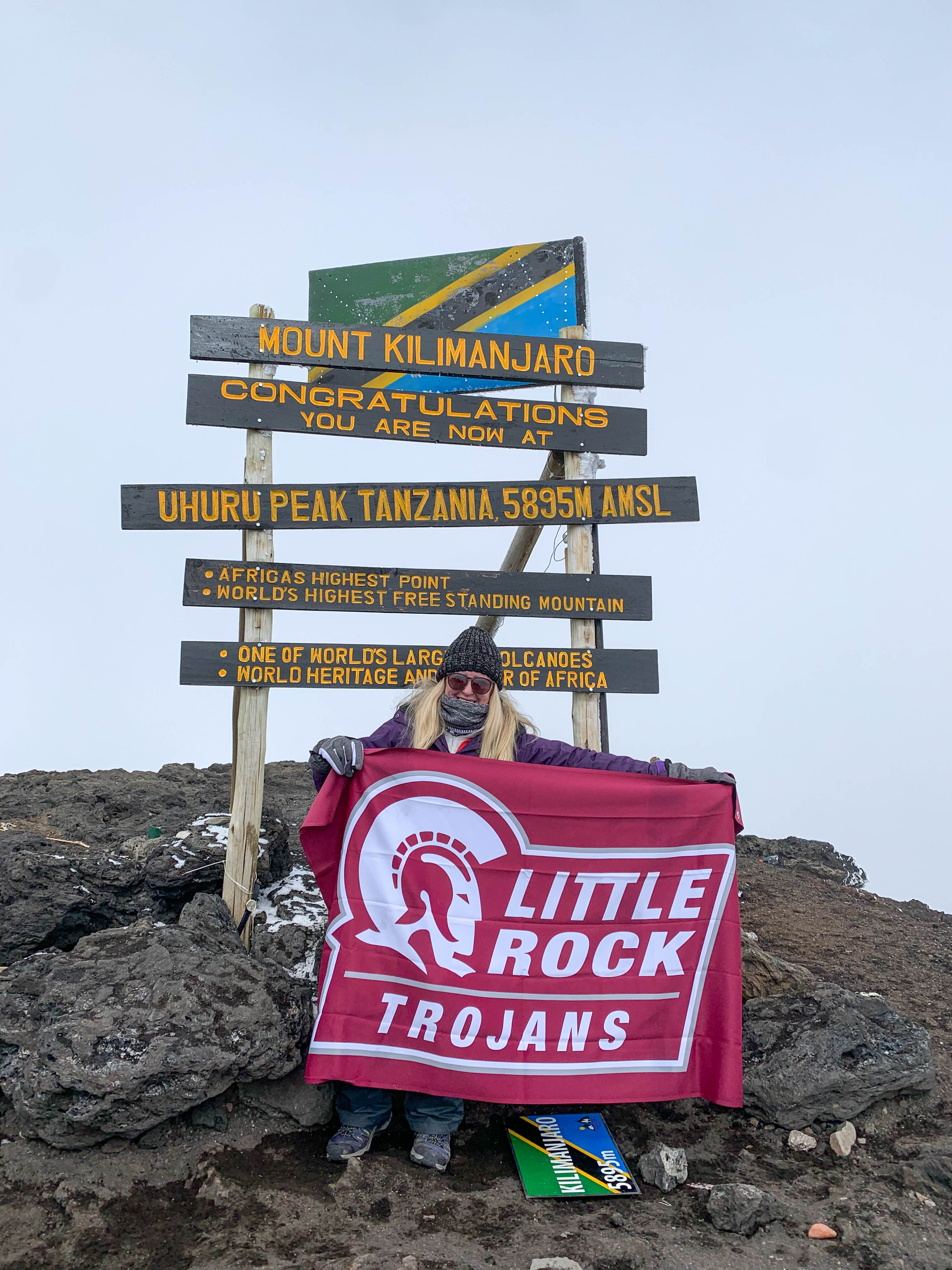 Coach Wylie flies UA Little Rock flag on Mount Kilimanjaro.