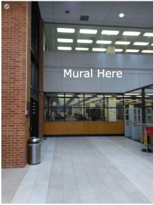 The mural will be located here, on the west side of the Ottenheimer Library lobby entrance.