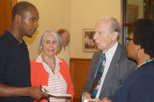 Dr. Allan Ward talks with members of the audience following a discussion of his book.