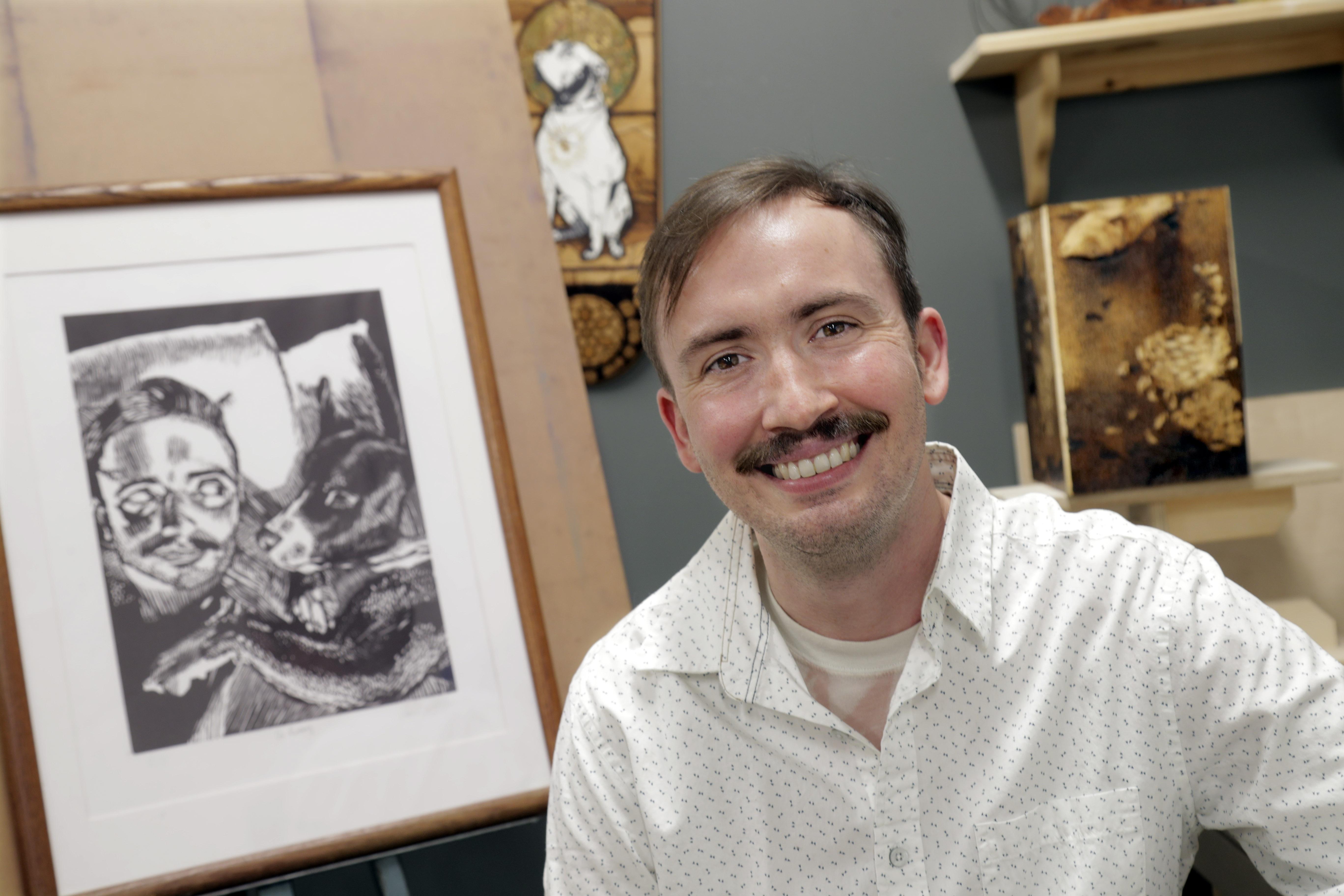 UA Little Rock studio art major Caleb LeFevre was awarded the Linda Blaine Flake Endowed Art Scholarship by philanthropist Leslye Shellam in celebration of World Art Day. Photo by Ben Krain.