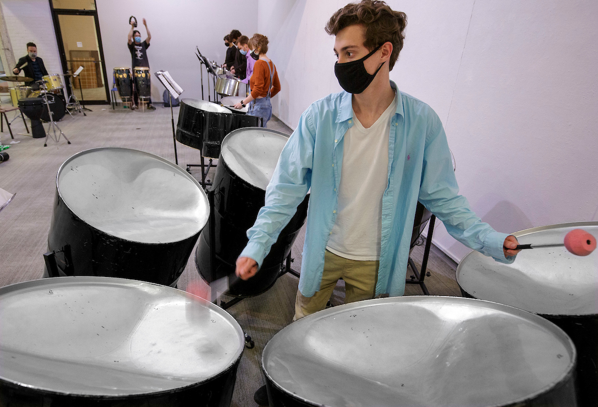 Six music students have formed a steel band ensmble. Several steel drum instruments were found in storage in the music department and refurbished by Assistant Professor of Percussion Justin Bunting, top left. Photo by Benjamin Krain.