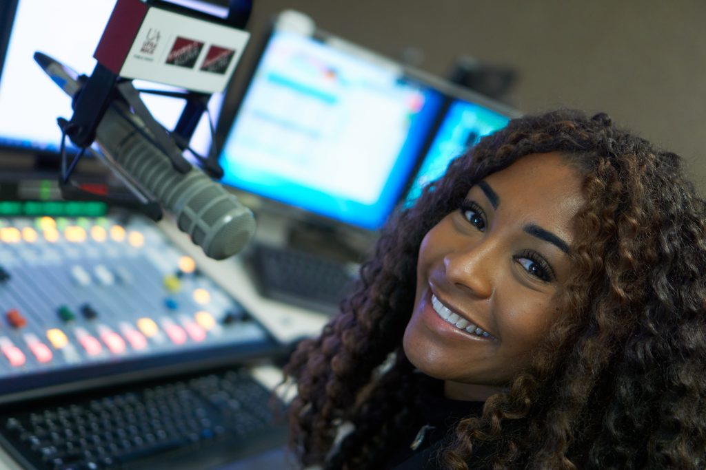 KUAR reporter Alex Brown is the 2021 recipient of the Arkansas Press Women annual scholarship. Photo courtesy of UA Little Rock Public Radio.