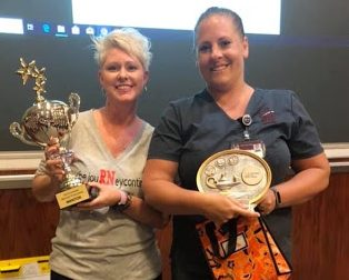 Nursing student Hannah Havens (right) stands with her mentor and previous nursing instructor, Janet Fletcher (left), after winning the UA Little Rock Nursing School Bracket Challenge. This competition takes place the first two semesters of nursing school and consists of check offs and quizzes that students were required to pass with a 100 percent on their first attempt.
