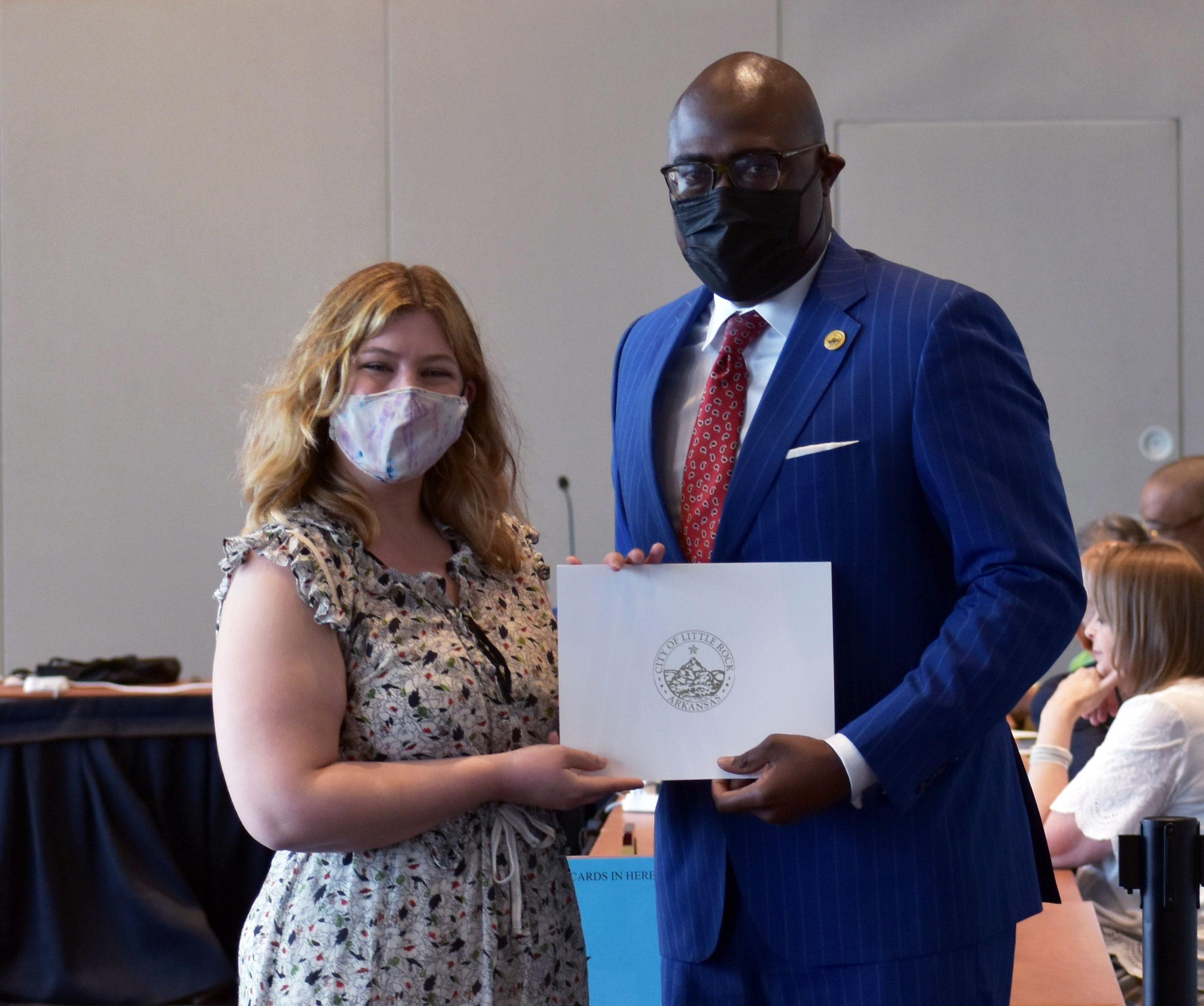 Little Rock Mayor Frank Scott Jr. presents Geneva Galloway with a certificate during her graduation from R.O.C.K. Academy.
