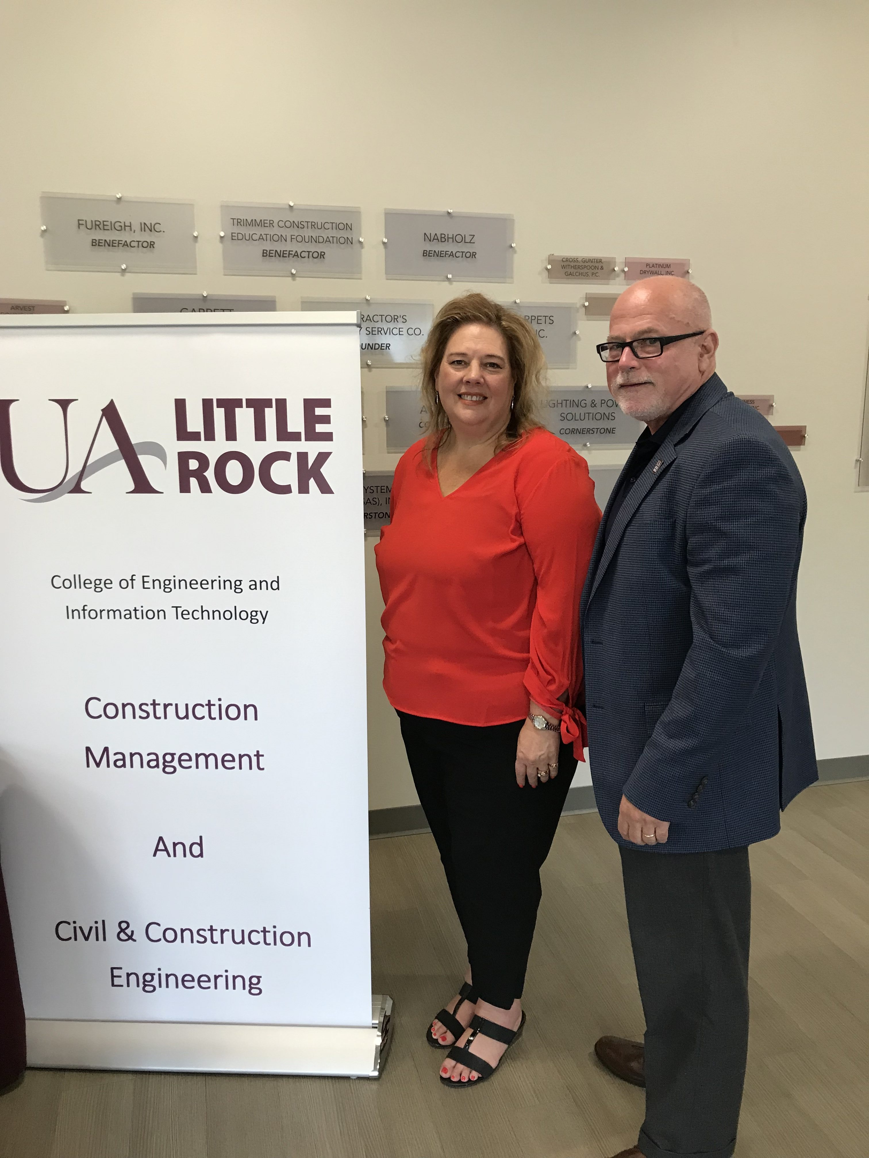 Dr. Cathy Riggins, left, and Dr. Hank Bray, right, discuss a new Associate of Construction Science Degree Partnership between UA Little Rock and Vilonia Pathways Academy Conversion Charter.