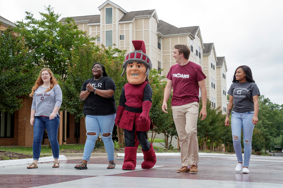 Maximus, the UA Little Rock mascot, is joined by students for marketing setups around campus. Photo by Ben Krain.