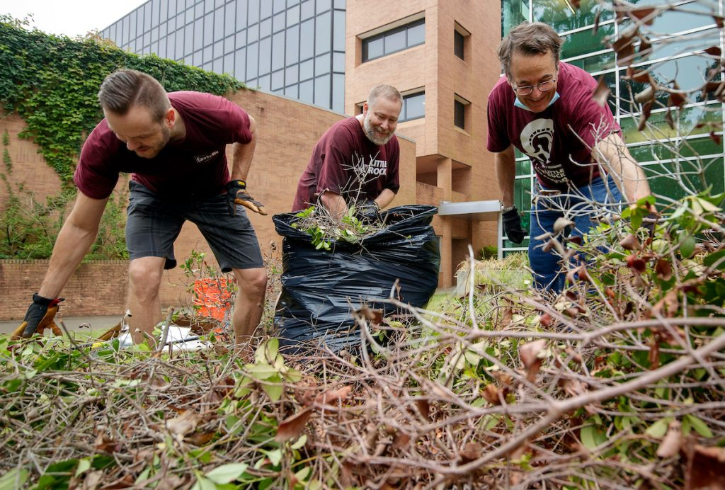 Information Technology Services staff members volunteer their time to help landscape and cleanup parts of campus. Photo by Ben Krain.