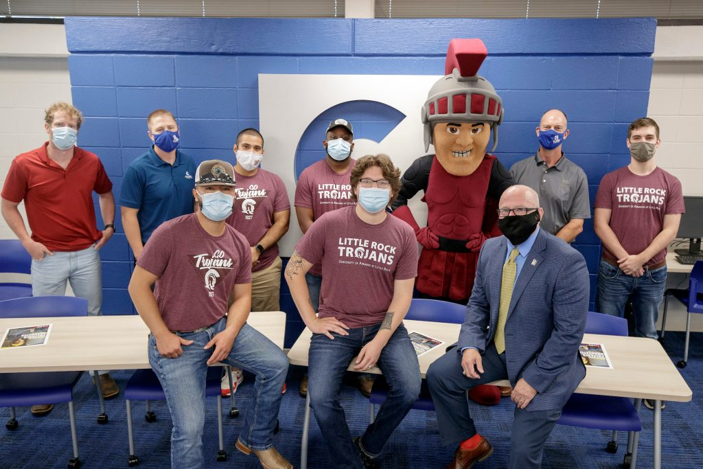 UA Little Rock staff and Construction Management students participate in a grand opening ribbon cutting ceremony dedicating a construction management classroom on campus. Clark Contractors helped pay for renovations to update the classroom. Photo by Ben Krain.