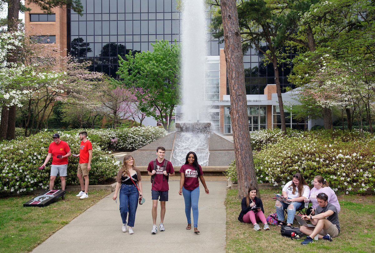 UA Little Rock students hanging out on campus by Cooper Fountain. Photo by Ben Krain.