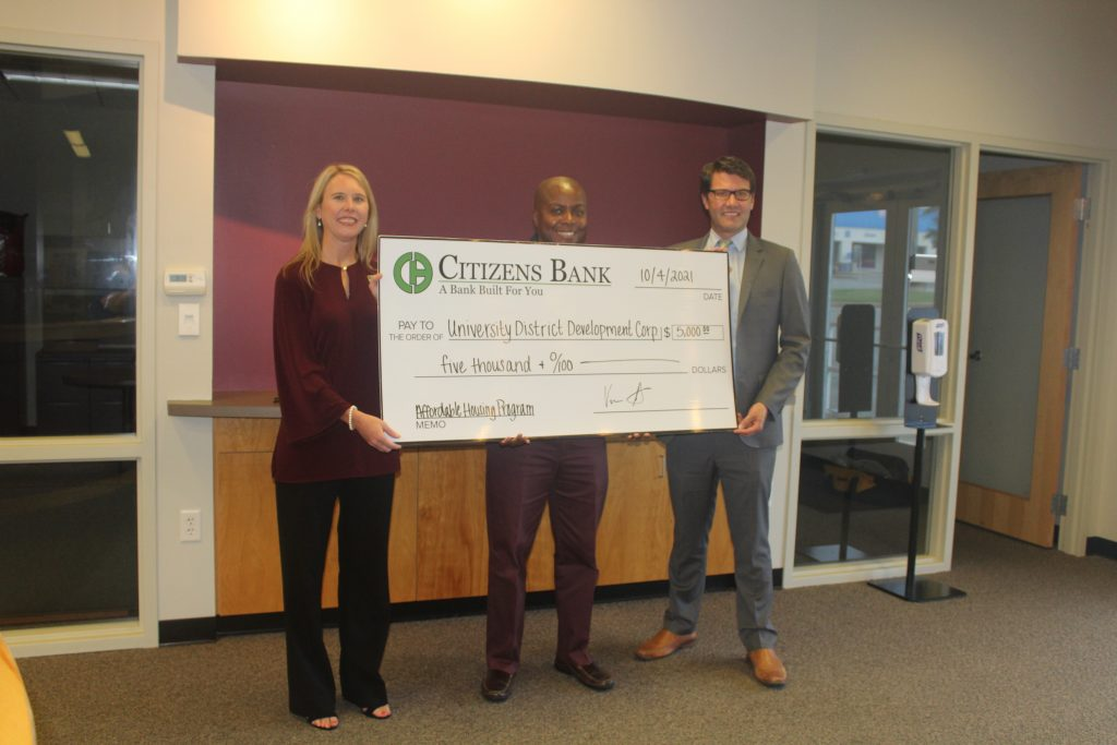 Citizens Bank representatives present a $5,000 donation to the University District Development Corporation to help with affordable housing efforts within University District. Pictured from left to right are Lisa Davis of Batesville, community reinvestment act officer and senior vice president, managing director of enterprise risk management, of Citizens Bank; Barrett Allen of Little Rock, executive director of University District Development Corporation; and Vernon Scott of Little Rock, regional president of Citizens Bank.