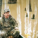 David Luneau searches for the Ivory-billed Woodpecker in the Big Woods of Arkansas in 2004 as a part of a research team that published a 2005 article in Science that talked about the sightings of the rare bird in Arkansas.
