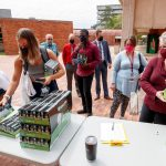 UA Little Rock students and staff take free lamps, power strips and LED light bulbs during an Earth Day event give-away sponsored by the Committee on Sustainability.