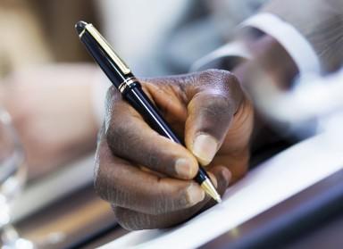 Man writing at conference