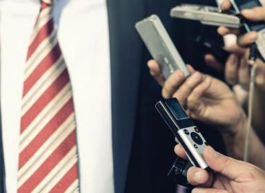 Journalists interviewing businessman