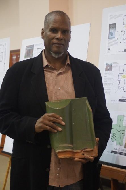 Kwendechi holding roof tile 2