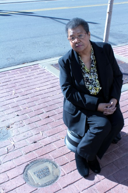 Elizabeth Eckford of the Little Rock Nine poses with her Civil Rights Heritage Marker