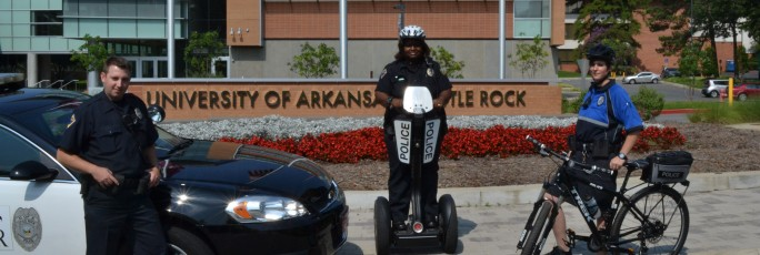 Public Safety officers by police car, on segway, on bike
