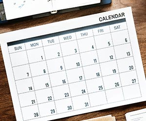 Monthly calendar sitting on a desktop.