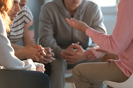 Photo of a group of people in a therapy session.