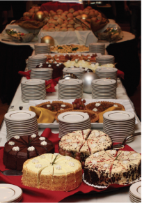 table set with cakes and dishes